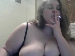 Huge DDD tit wife smokes while playing with her big tits and hard nipples