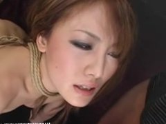 Gorgeous tied Oriental babe learns to suck cock and ride fuck machine