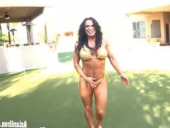 Big beautiful bodybuilder strips and flexes her big strong muscles