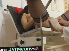 Spy cam video of a gorgeous babe vaginal specula exam