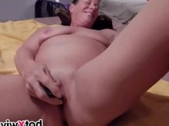 Chubby wife inserts a banana in her cunt