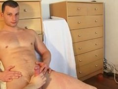 Straight hunk gets wanked his huge cock by a guy despite of himself.