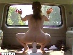 Babe riding big dildo in moving van