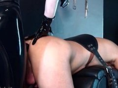 Rubber mistress strap on fucks slave