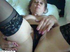 Sexy brunette MILF in hotel