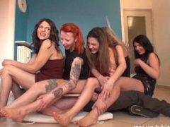 5 girls sit on guy under board