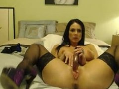 Busty Milf plays with a dildo before shaking her ass.
