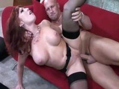 Redhead getting fucked on a couch in sheer stockings and high heels