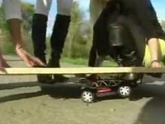 Weight fetish, 6 girls crush a toy car under a board