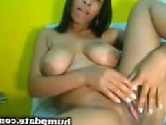 Ebony with big tits toying her pussy