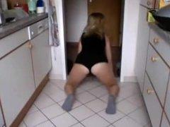 blonde teen dancing in the kitchen