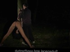 Skinny slave humiliated and used by her Master by night in the woods