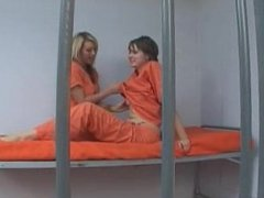 blonde and brunette have lesbian sex in the slammer