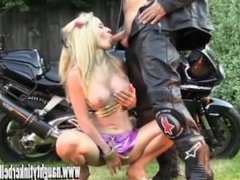 Naughty blonde babe pumping pussy and anal fucking sex toy on motorbike