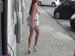 Cute french slut with eyeglass shows her pussy in street