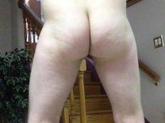 Wearing tight thongs, strip