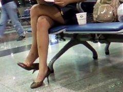 Mature Asian nice sexy legs dangling in public