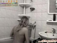 WEBCAM-blonde-on-camera-in-her-bathroom by www.x-rated.biz