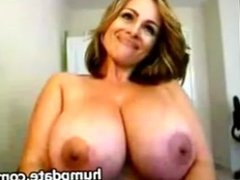 MILF with massive breasts toying her pussy