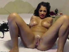 Oiled big titted latina Claudia Smith with BJ lips