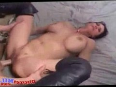 Horny brunette milf with boots get fucked on bed