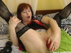 Mature woman uses big red brutal dildo plug on her pussy and asshole in HD