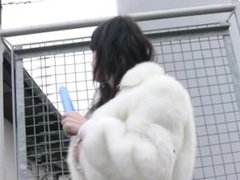 Hot girl masturbates outside in fur coat and boots