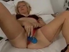 Hot blonde mature plays with dildo via DATES25.COM