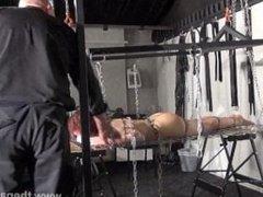 Redhead amateur slavegirl Bembys metal bondage lowered over burning candles