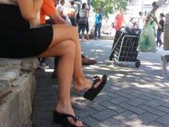 Candid blonde shoeplay dangling flip flops feet face via DATES25.COM