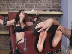 Tied up brunette gets her soles licked