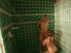 Hot MILF enjoying lesbian sex in the bathroom
