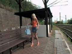 Amazing blonde rubs her pussy at the train station