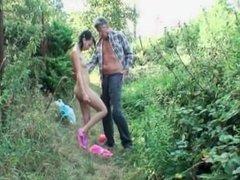 Slutty teen sucks cock in nature