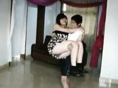 chinese girl lift and carry a small man