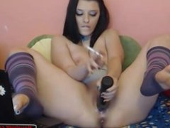 Sandra plays with her dildo at home