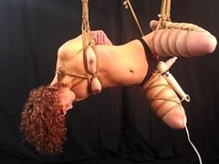 Cumming while bound in a rope suspension