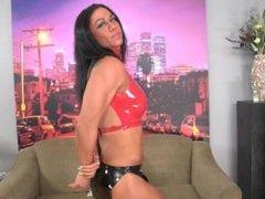girl flexing biceps in red latex top