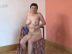 Hairy granny with big tits plays w