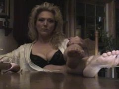 Milf removing heels and showing feet soles on the table