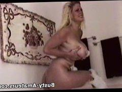 Busty Heather masturbates in the bathtub