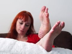 Cute redhead MILF takes off her socks to tease with her sexy wrinkled soles