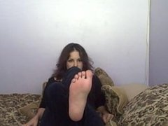 She wants you to stroke your cock as you tickle her ticklish bare feet JOI