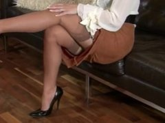 Beautiful woman masturbating in nylons and heels.