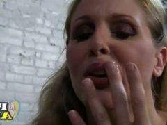 Big tit blonde MILF gives a handjob