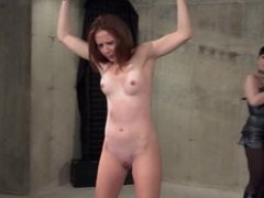Tied up ginger gets her pussy played with