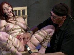 Redhead slut gets bondage and punish indoors.