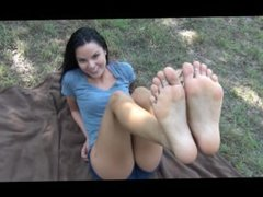 Sexy feet tickled at the park