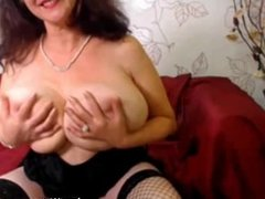 Granny with huge natural tits plays with her pussy on webcam