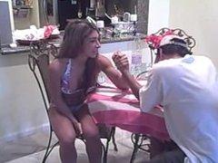 Buff young bikini girl armwrestles a man